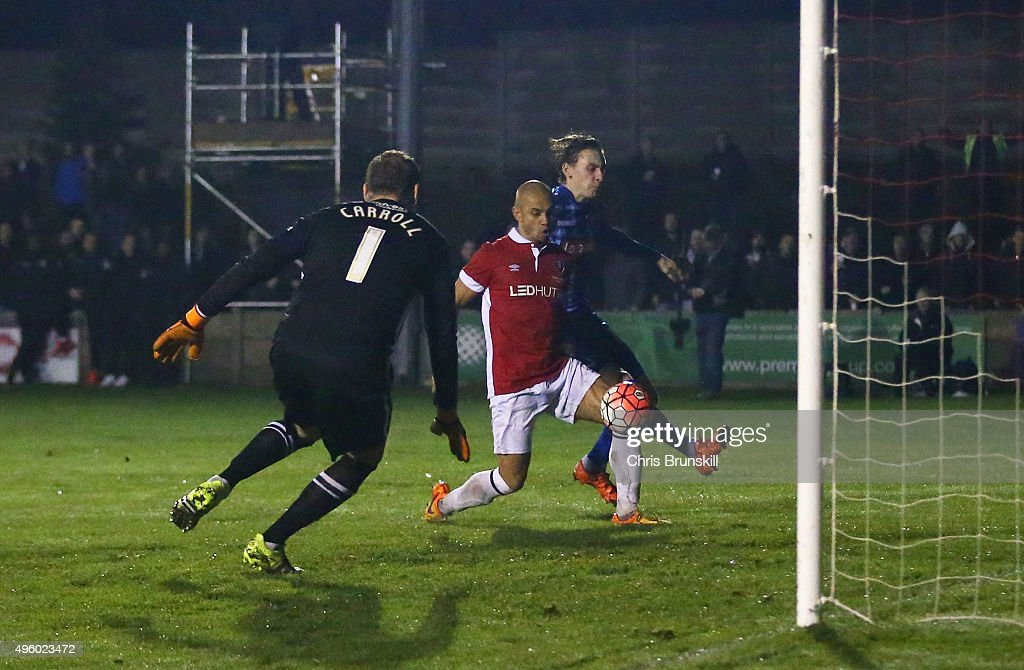 Danny Webber of Salford City (C) scores their first goal past goalkeeper Roy Carroll of Notts County during the Emirates FA Cup first round match between Salford City and Notts County at Moor Lane on November 6, 2015 in Salford, England.