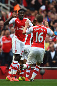 Danny Welbeck and Aaron Ramsey of Arsenal celebrate after Jack Wilshere of Arsenal scores their first goal during the Barclays Premier League match...