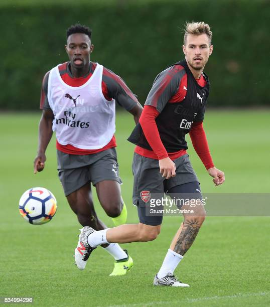 Danny Welbeck and Aaron Ramsey of Arsenal during a training session at London Colney on August 18 2017 in St Albans England