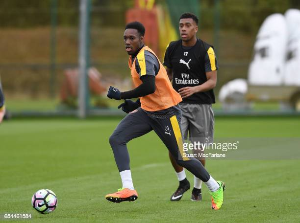 Danny Welbeck and Alex Iwobi of Arsenal during a training session at London Colney on March 17 2017 in St Albans England