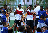 Danny Welbeck and Daniel Sturridge of England laugh during a visit to Complexo Esportivo da Rocinha on June 9 2014 in Rio de Janeiro Brazil