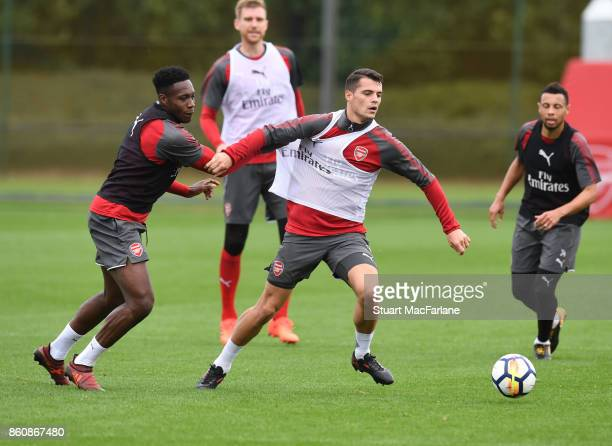 Danny Welbeck and Granit Xhaka of Arsenal during a training session at London Colney on October 13 2017 in St Albans England