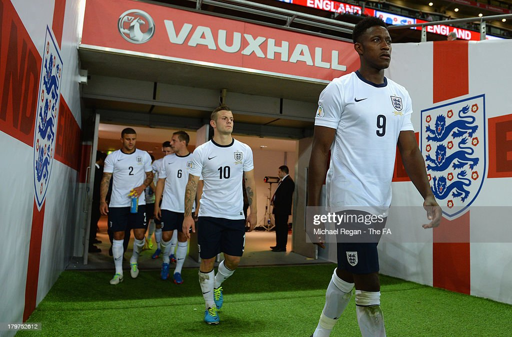 Danny Welbeck and Jack Wilshere of England walk out for the 2nd half during the FIFA 2014 World Cup Qualifying Group H match between England and Moldova at Wembley Stadium on September 6, 2013 in London, England.