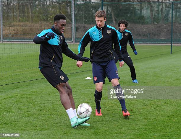 Danny Welbeck and Krystian Bielik of Arsenal in action during a training session at London Colney on March 4 2016 in St Albans England