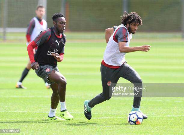 Danny Welbeck and Mohamed Elneny of Arsenal during a training session at London Colney on August 10 2017 in St Albans England