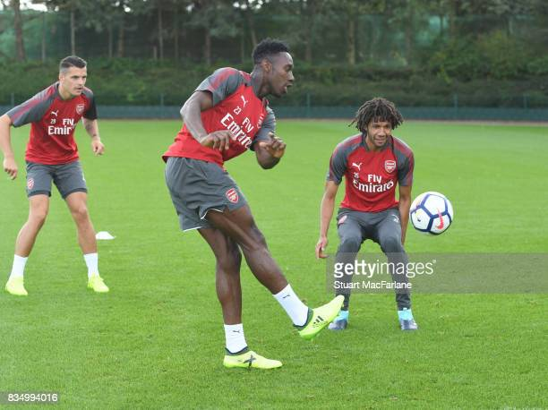 Danny Welbeck and Mohamed Elneny of Arsenal during a training session at London Colney on August 18 2017 in St Albans England
