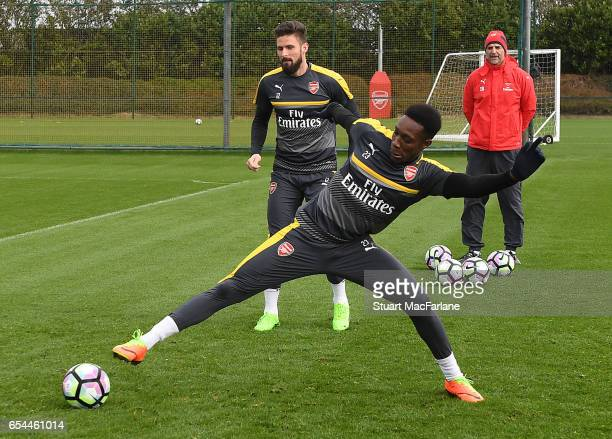 Danny Welbeck and Olivier Giroud of Arsenal during a training session at London Colney on March 17 2017 in St Albans England