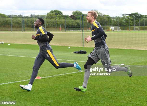 Danny Welbeck and Per Mertesacker of Arsenal during a training session at London Colney on May 20 2017 in St Albans England