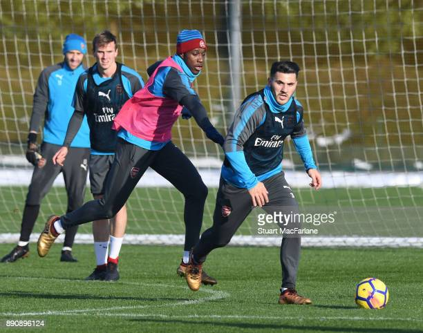 Danny Welbeck and Sead Kolasinac of Arsenal during a training session at London Colney on December 12 2017 in St Albans England