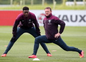 Danny Welbeck and Wayne Rooney warm up during a training session at St Georges Park on May 27 2014 in BurtonuponTrent England