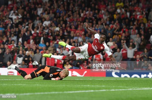 Danny Welbeck beats Leciester goalkeeper Kasper Schmeichel to socre the 2nd goal during the Premier League match between Arsenal and Leicester City...