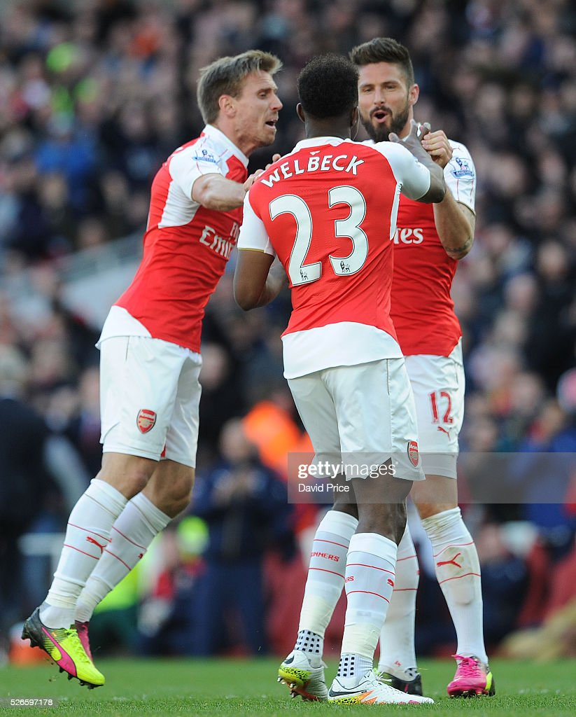 Danny Welbeck celebrates scoring Arsenal's goal with Olivier Giroud and Nacho Monreal of Arsenal during the Barclays Premier League match between Arsenal and Norwich City at on April 30th, 2016 in London, England
