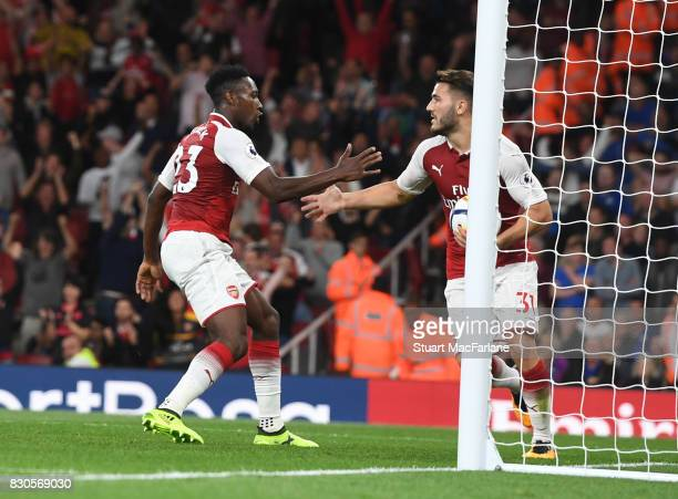 Danny Welbeck celebrates scoring the 2nd Arsenal goal with Sead Kolasinac during the Premier League match between Arsenal and Leicester City at...