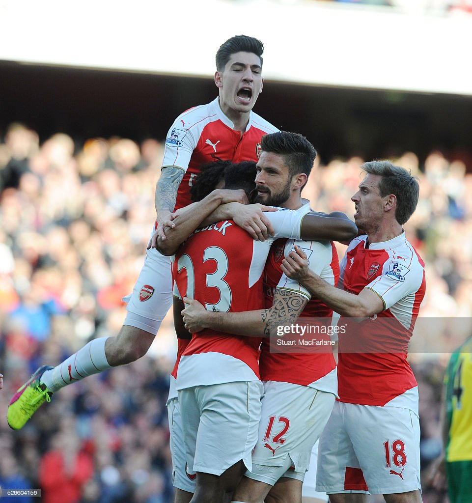 <a gi-track='captionPersonalityLinkClicked' href=/galleries/search?phrase=Danny+Welbeck&family=editorial&specificpeople=4223930 ng-click='$event.stopPropagation()'>Danny Welbeck</a> celebrates scoring the Arsenal goal with (L) Hector Bellerin, (2ndR) <a gi-track='captionPersonalityLinkClicked' href=/galleries/search?phrase=Olivier+Giroud&family=editorial&specificpeople=5678034 ng-click='$event.stopPropagation()'>Olivier Giroud</a> and (R) <a gi-track='captionPersonalityLinkClicked' href=/galleries/search?phrase=Nacho+Monreal&family=editorial&specificpeople=4078049 ng-click='$event.stopPropagation()'>Nacho Monreal</a> during the Barclays Premier League match between Arsenal and Norwich City at Emirates Stadium on April 30, 2016 in London, England.