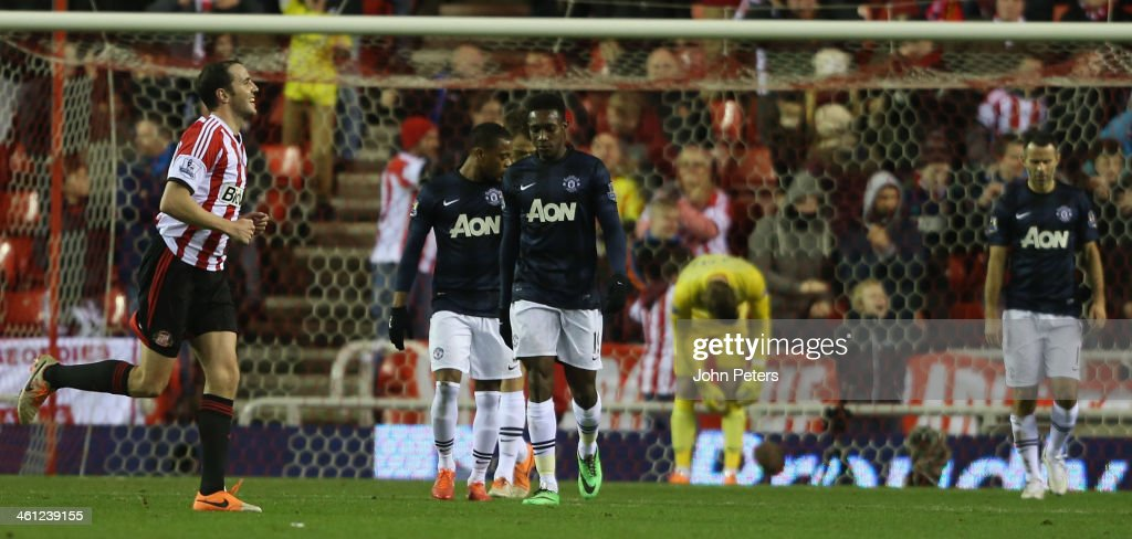 Danny Welbeck, David de Gea and Ryan Giggs of Manchester Unitedreact to Ryan Giggs scoring an own-goal during the Capital One Cup Semi-Final first leg between Sunderland and Manchester United at Stadium of Light on January 7, 2014 in Sunderland, England.