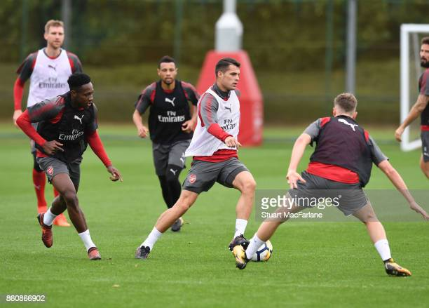Danny Welbeck Granit Xhaka and Rob Holding of Arsenal during a training session at London Colney on October 13 2017 in St Albans England