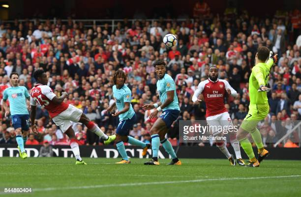 Danny Welbeck heads past Bournemouth goalkeeper Asmir Begovic to score for Arsenal during the Premier League match between Arsenal and AFC...