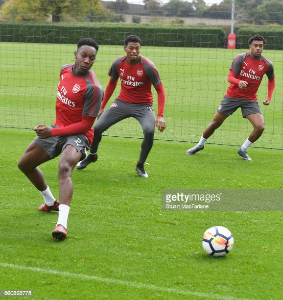 Danny Welbeck Jeff ReineAdelaide and aAlex Iwobi of Arsenal during a training session at London Colney on October 13 2017 in St Albans England