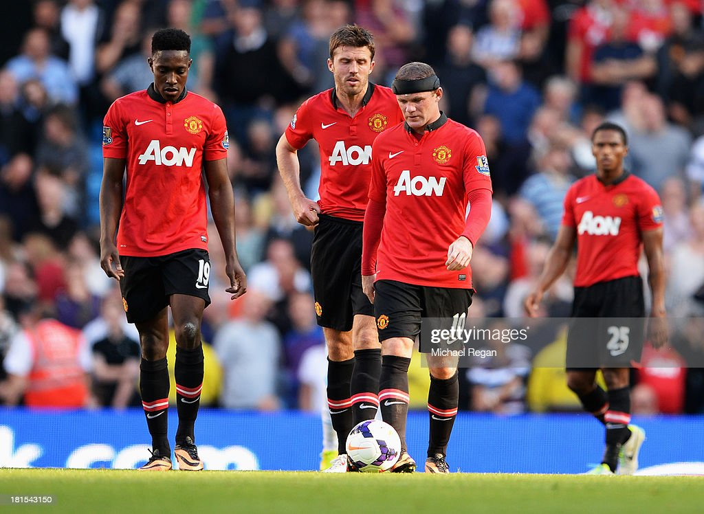 Danny Welbeck, Michael Carrick, Wayne Rooney and Luis Antonio Valencia of Manchester United look dejected as Yaya Toure of Manchester City (not pictured) scores their second goal during the Barclays Premier League match between Manchester City and Manchester United at the Etihad Stadium on September 22, 2013 in Manchester, England.
