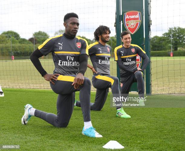 Danny Welbeck Mohamed Elneny and Mesut Ozil of Arsenal during a training session at London Colney on May 20 2017 in St Albans England