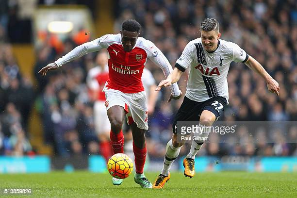 Danny Welbeck of Arsenal and Kevin Wimmer of Tottenham Hotspur compete for the ball during the Barclays Premier League match between Tottenham...