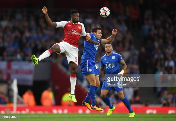 Danny Welbeck of Arsenal and Matty James of Leicester City compete for a header during the Premier League match between Arsenal and Leicester City at...