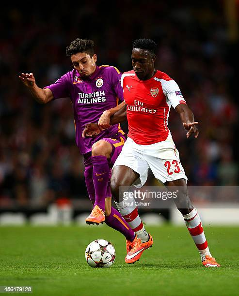 Danny Welbeck of Arsenal battles for the ball with Alex Telles of Galatasaray AS during the UEFA Champions League group D match between Arsenal FC...