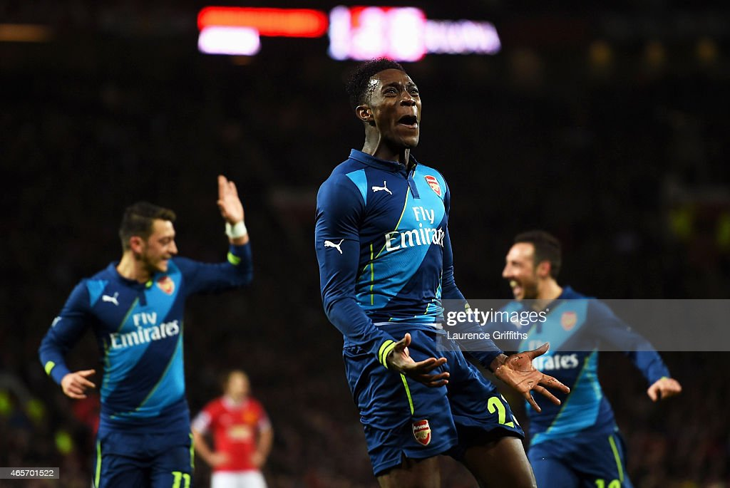 <a gi-track='captionPersonalityLinkClicked' href=/galleries/search?phrase=Danny+Welbeck&family=editorial&specificpeople=4223930 ng-click='$event.stopPropagation()'>Danny Welbeck</a> of Arsenal celebrates after scoring his team's second goal during the FA Cup Quarter Final match between Manchester United and Arsenal at Old Trafford on March 9, 2015 in Manchester, England.