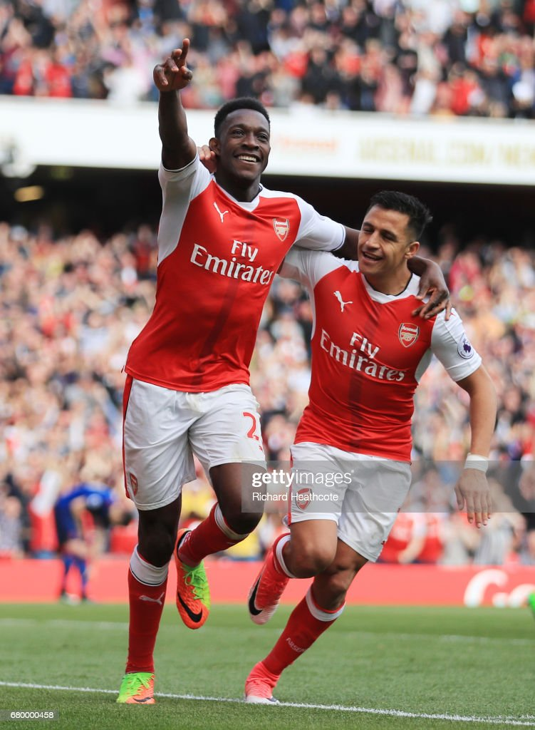 Danny Welbeck of Arsenal celebrates scoring his sides second goal with Alexis Sanchez of Arsenal during the Premier League match between Arsenal and Manchester United at the Emirates Stadium on May 7, 2017 in London, England.
