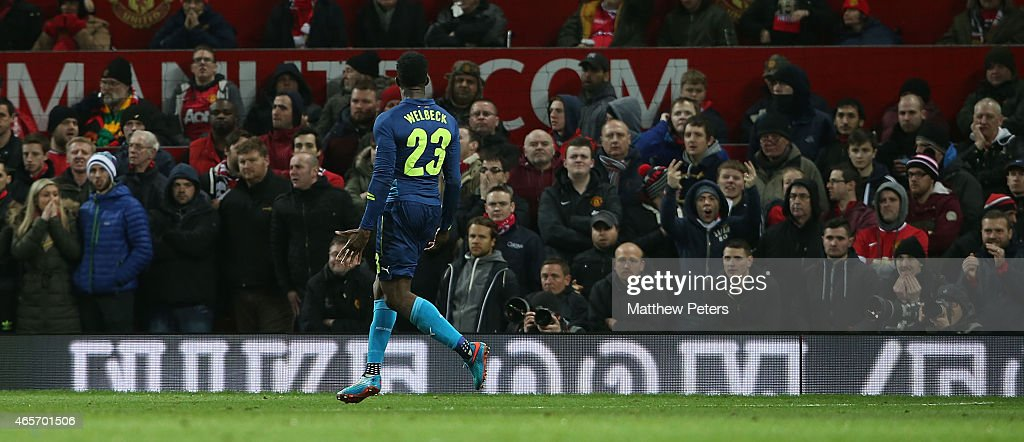 Danny Welbeck of Arsenal celebrates scoring their second goal during the FA Cup Quarter Final match between Manchester United and Arsenal at Old...