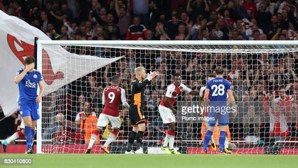 Danny Welbeck of Arsenal celebrates scoring to make it 22 during the Premier League match between Arsenal and Leicester City at Emirates Stadium on...