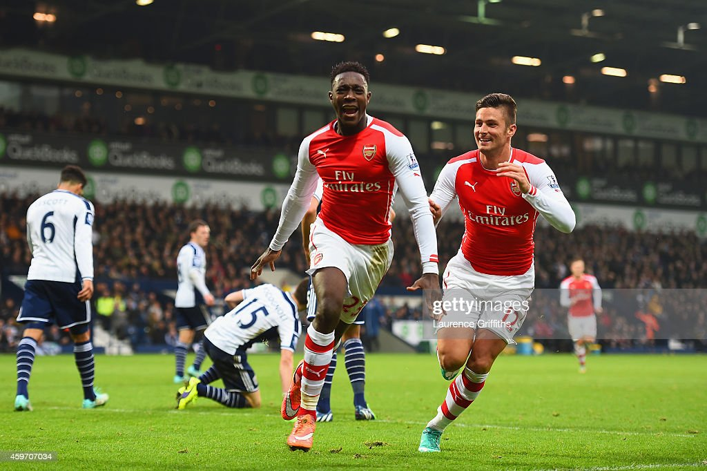 Danny Welbeck of Arsenal celebrates with team mate Olivier Giroud as he scores their first goal during the Barclays Premier League match between West...
