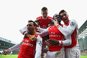 Danny Welbeck of Arsenal celebrates with team mate Olivier Giroud Santi Cazorla and Calum Chambers as he scores their first goal during the Barclays...