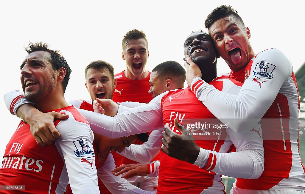<a gi-track='captionPersonalityLinkClicked' href=/galleries/search?phrase=Danny+Welbeck&family=editorial&specificpeople=4223930 ng-click='$event.stopPropagation()'>Danny Welbeck</a> of Arsenal (2R) celebrates with team mates <a gi-track='captionPersonalityLinkClicked' href=/galleries/search?phrase=Olivier+Giroud&family=editorial&specificpeople=5678034 ng-click='$event.stopPropagation()'>Olivier Giroud</a>, <a gi-track='captionPersonalityLinkClicked' href=/galleries/search?phrase=Santi+Cazorla&family=editorial&specificpeople=709830 ng-click='$event.stopPropagation()'>Santi Cazorla</a>, <a gi-track='captionPersonalityLinkClicked' href=/galleries/search?phrase=Calum+Chambers+-+Soccer+Player&family=editorial&specificpeople=10599271 ng-click='$event.stopPropagation()'>Calum Chambers</a> and <a gi-track='captionPersonalityLinkClicked' href=/galleries/search?phrase=Aaron+Ramsey+-+Soccer+Player&family=editorial&specificpeople=4784114 ng-click='$event.stopPropagation()'>Aaron Ramsey</a> of Arsenal as he scores their first goal during the Barclays Premier League match between West Bromwich Albion and Arsenal at The Hawthorns on November 29, 2014 in West Bromwich, England.