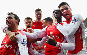 Danny Welbeck of Arsenal celebrates with team mates Olivier Giroud Santi Cazorla Calum Chambers and Aaron Ramsey of Arsenal as he scores their first...