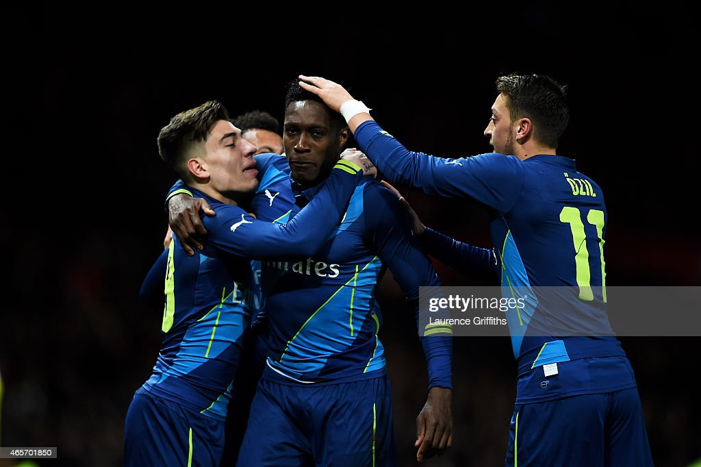 Danny Welbeck of Arsenal celebrates with teammates Hector Bellerin and Mesut Oezil of Arsenal after scoring his team's second goal during the FA Cup...