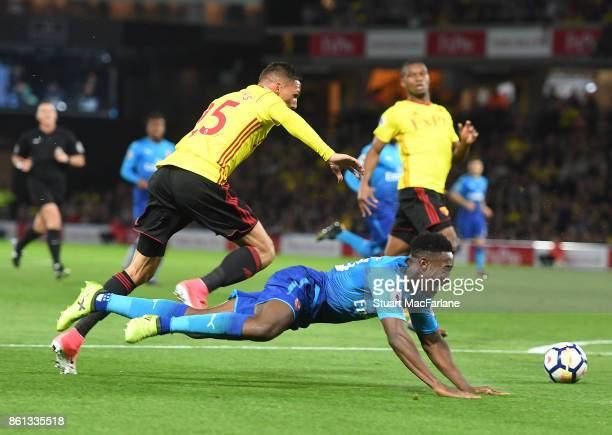 Danny Welbeck of Arsenal challenged by Jose Holebas of Watford during the Premier League match between Watford and Arsenal at Vicarage Road on...