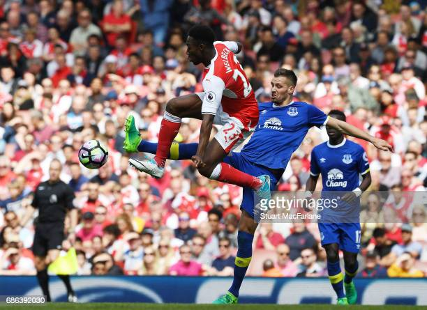 Danny Welbeck of Arsenal challenged by Morgan Schneiderlin of Everton during the Premier League match between Arsenal and Everton at Emirates Stadium...
