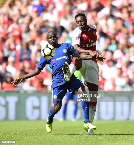 Danny Welbeck of Arsenal challenges N'Golo Kante of Chelsea during the match between Chelsea and Arsenal at Wembley Stadium on August 6 2017 in...