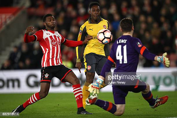 Danny Welbeck of Arsenal chips Harry Lewis of Southampton to score his sides first goal during the Emirates FA Cup Fourth Round match between...