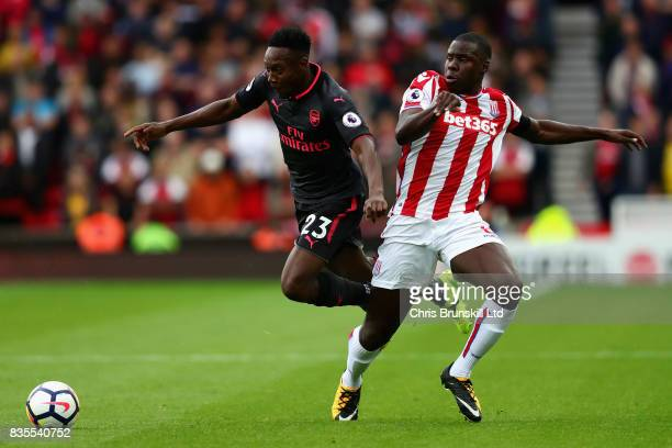 Danny Welbeck of Arsenal dribbles past Kurt Zouma of Stoke City during the Premier League match between Stoke City and Arsenal at Bet365 Stadium on...