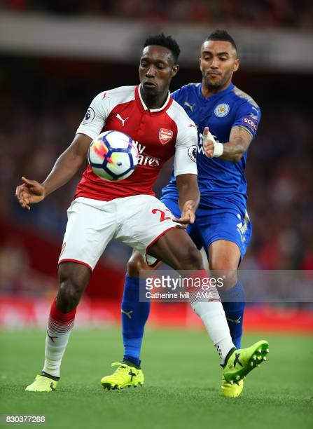 Danny Welbeck of Arsenal holds off Danny Simpson of Leicester City during the Premier League match between Arsenal and Leicester City at Emirates...