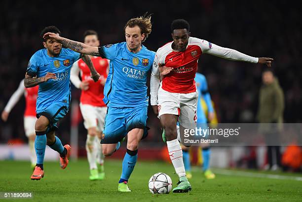 Danny Welbeck of Arsenal holds off the challenge from Ivan Rakitic of Barcelona during the UEFA Champions League round of 16 first leg match between...