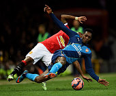 Danny Welbeck of Arsenal is brought down by Ashley Young of Manchester United during the FA Cup Quarter Final match between Manchester United and...