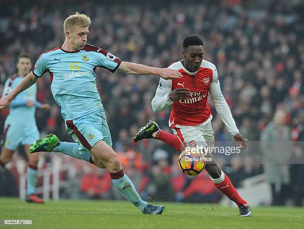 Danny Welbeck of Arsenal is challenged by Ben Mee of Burnley during the Premier League match between Arsenal and Burnley at Emirates Stadium on...