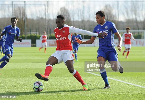 Danny Welbeck of Arsenal is challenged by Richard Nartey of Chelsea during the match between Arsenal U23 and Chelsea U23 at London Colney on February...