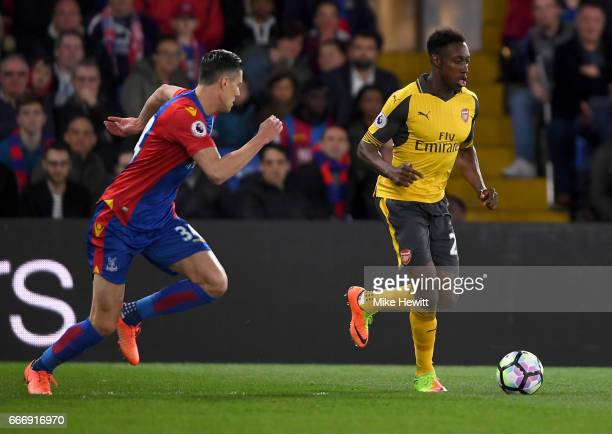 Danny Welbeck of Arsenal is chased by Martin Kelly of Crystal Palace during the Premier League match between Crystal Palace and Arsenal at Selhurst...