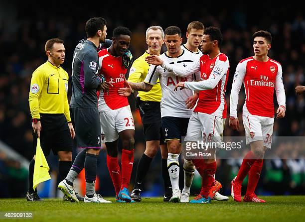 Danny Welbeck of Arsenal is held back by Hugo Lloris of Tottenham Hotspur as he exchanges words with Kyle Walker of Tottenham Hotspur during the...
