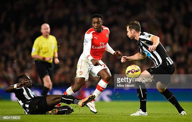 Danny Welbeck of Arsenal is tackled by Cheik Ismael Tiote of Newcastle United during the Barclays Premier League match between Arsenal and Newcastle...