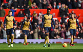 Danny Welbeck of Arsenal looks dejected with team mates during the Barclays Premier League match between Manchester United and Arsenal at Old...